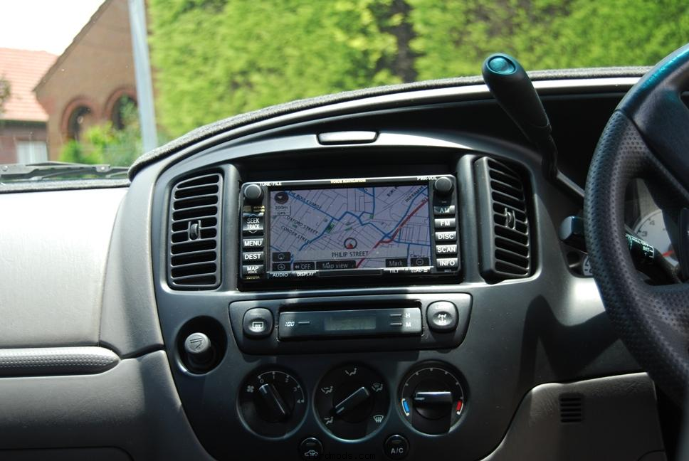 03 Ford Escape with Toyota Prado SatNav..